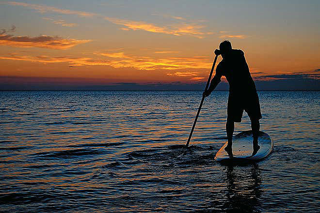 Chilika paddle boarding amazing sunset and tranquility. India is a one of the best countries to paddle board in and has a growing scene.