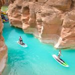 two people paddle boarding in the grand canyon