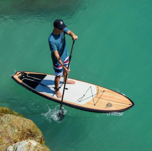 Man using Cruiser bamboo paddleboard