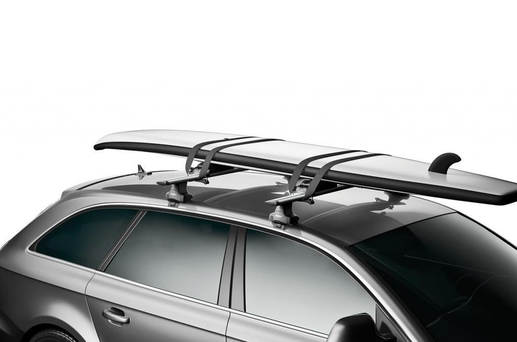 Paddleboard on top of a car secured by the Thule SUP rack